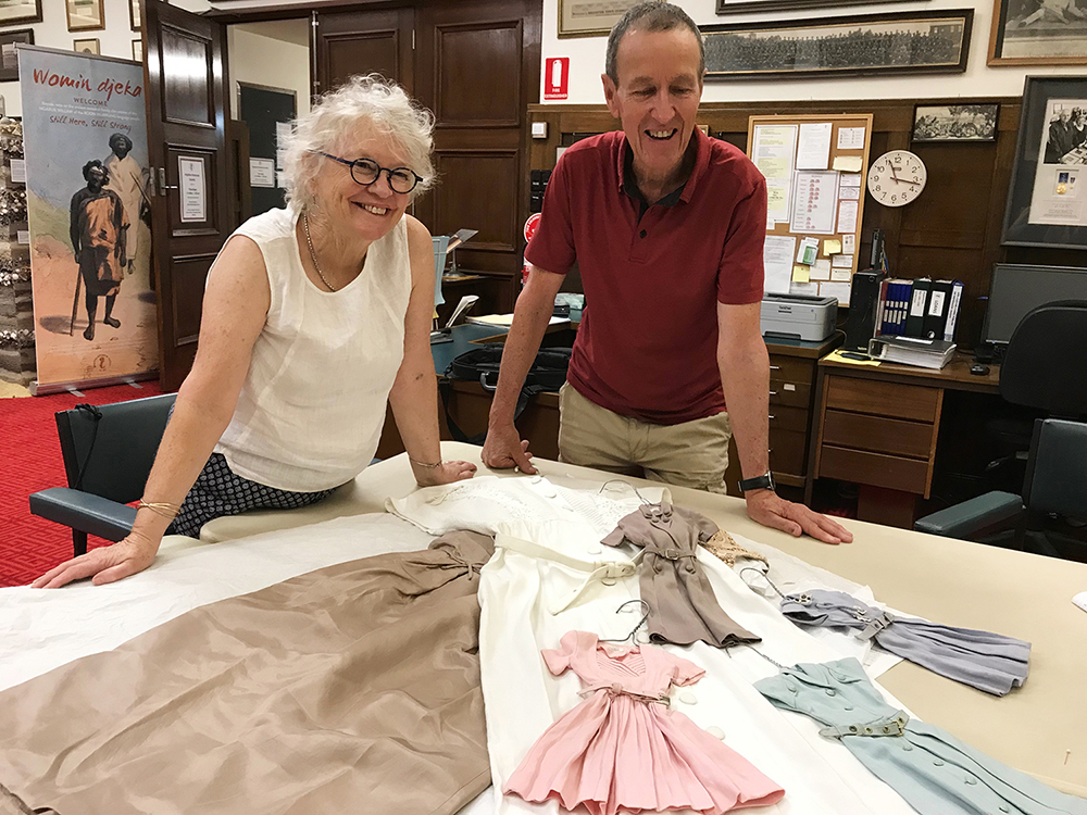 Judy and Ken Paynter with some of the treasures of their collection: four doll-sized replicas of Gala's most popular 1956 styles.